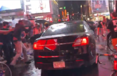 Watch: A car drives through Black Lives Matter protesters in Times Square